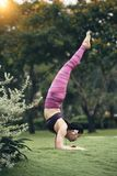 Handstand. Side view of Asian young woman performing handstand Royalty Free Stock Photos