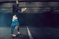 Handstand on a skateboard. Man does Handstand on a skateboard Royalty Free Stock Images