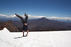 Handstand on snow at Mount Ruapehu Stock Photo