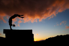 Handstand in sunset Royalty Free Stock Photography
