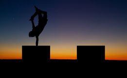 Handstand in sunset Stock Photos