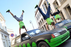 Handstand trick on the top of car. Stock Photos