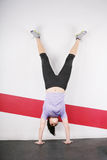 Handstand woman Stock Photography