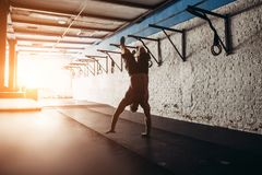Handstanding for athletic man. In fitness g Royalty Free Stock Photos
