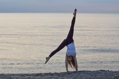 Free Handstands At The Beach Stock Images - 100007114