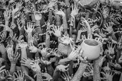 Handstaty från helvete i Wat Rong Khun på Chiang Rai, Thailand Royaltyfria Bilder