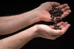 Handswith coffee isolated on black background Stock Images