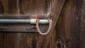 Handtag för hästskoladugårddörr, färgbild Arkivbilder