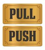 Handtag och push - guld- dörrtecken Arkivbilder