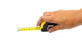Handtag som mäter bandet som isoleras på vit bakgrund Arkivfoto