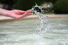Handtanzen mit Wasser Stockbilder