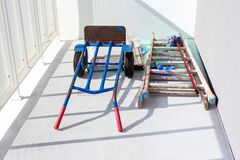 Free Handtruck And A Wooden Painter Ladder And A Mop Laying On The White Balcony. House Or Flat Under Construction Abstract Concept Royalty Free Stock Images - 174129249