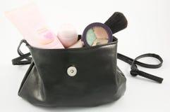 Handväska med makeup Fotografering för Bildbyråer