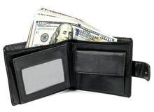 Handväska med pengar på vit bakgrund royaltyfri foto