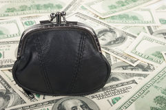 Handväska och dollar Arkivfoto