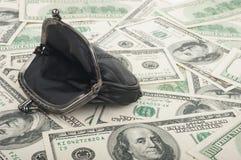 Handväska och dollar Arkivbild