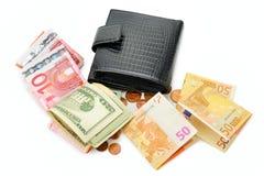 Handväska och pappers- pengar Royaltyfri Foto