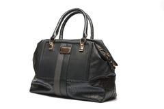 Handväska på en vitbakgrund royaltyfri foto