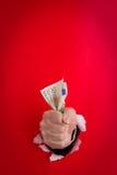 Handvoll Geld stockfotografie