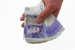 Handvoll Geld lizenzfreies stockbild