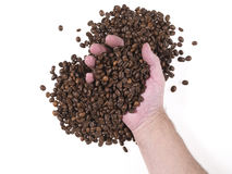 Handvoll Kaffeebohnen Stockbild