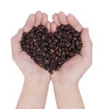 Handvoll Kaffeebohnen Lizenzfreie Stockbilder