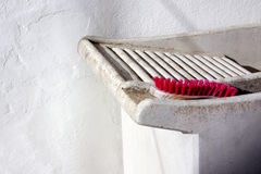 Handwash. Detail of a laundry hand washing tub with an old pink brush Royalty Free Stock Image