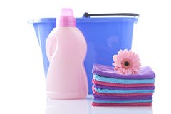 Handwash laundry concept. Laundry softener and clean towels with flower Royalty Free Stock Photography
