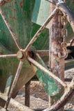 Handwheel on an old green concrete bucket Royalty Free Stock Photo
