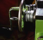 Handwheel of old green milling machine with numbers. Close up royalty free stock photography