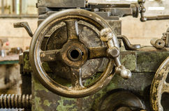 Handwheel of old lathe machine. Close up of Handwheel of old lathe machine in old factory Royalty Free Stock Photo