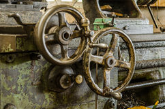Handwheel of old lathe machine. Close up of Handwheel of old lathe machine in old factory Stock Images