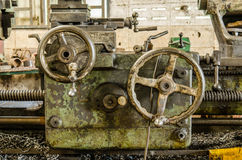 Handwheel of old lathe machine. Handwheel of old lathe machine in old factory Stock Image