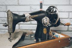The handwheel vintage sewing machine Stock Photos