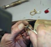 Handwork. Hands of working jeweler. handwork Stock Photo