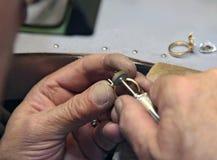 Handwork. Hands of working jeweler. handwork Royalty Free Stock Photography