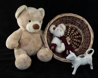 Handwoven Basket with Teddy Bear, Bunny, and Cow Stock Image
