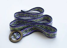 Handwoven belting. Photo of the handwoven belt with buckle on a white background Royalty Free Stock Photos