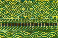 Handwoven Gewebe der Gewebefarbeantike, natürliche Färbungsgewebe, schöne Farben, schöne Gewebe, alte Modegewebeseide thailändisc Stockfoto