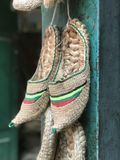Handwoven pointy toed slippers from Nepal. In a market in the Kathmandu valley stock images
