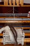 Handwoven wool rug on weaving loom Stock Photos