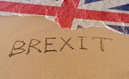 Handwrite text Brexit on sand coastline. And foam wave with Great Britain flag pattern. On referendum, voted to exit United Kingdom from EU knows as Brexit stock images