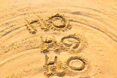 Handwriting Święty Mikołaj na piasku Ho Ho Ho obraz stock