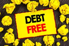 Handwriting Announcement text  Debt Free. Conceptual photo Credit Money Financial Sign Freedom From Loan Mortage written on Yellow. Handwriting Announcement text Royalty Free Stock Images