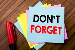 Handwriting Announcement text Do Not Forget.  Concept for Don t memory Remider Written on sticky stick note paper with wooden back. Handwriting Announcement text Stock Image