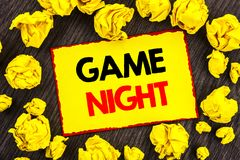 Handwriting Announcement text Game Night. Conceptual photo Entertainment Fun Play Time Event For Gaming written on Yellow Stikcy. Handwriting Announcement text stock photo