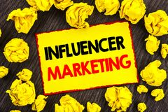 Handwriting Announcement text Influancer Marketing. Conceptual photo Social Media Online Influence Strategy written on Yellow Sti stock photography