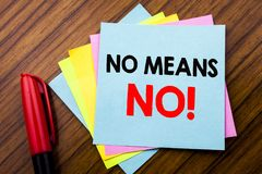 Handwriting Announcement text No Means No.  Concept for Stop Anti Rape Slogan Written on sticky stick note paper with wooden backg. Handwriting Announcement text Stock Image