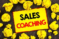 Handwriting Announcement text  Sales Coaching. Conceptual photo Business Goal Achievement Mentoring written on Yellow Stikcy Note. Handwriting Announcement text Stock Images