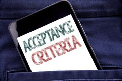 Handwriting Announcement text showing Acceptance Criteria. Business concept for Digital Criterion Written phone mobile phone, cell. Phone placed in man front Royalty Free Stock Photo